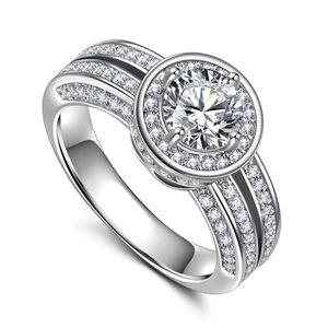 Round Cut White Sapphire Ring